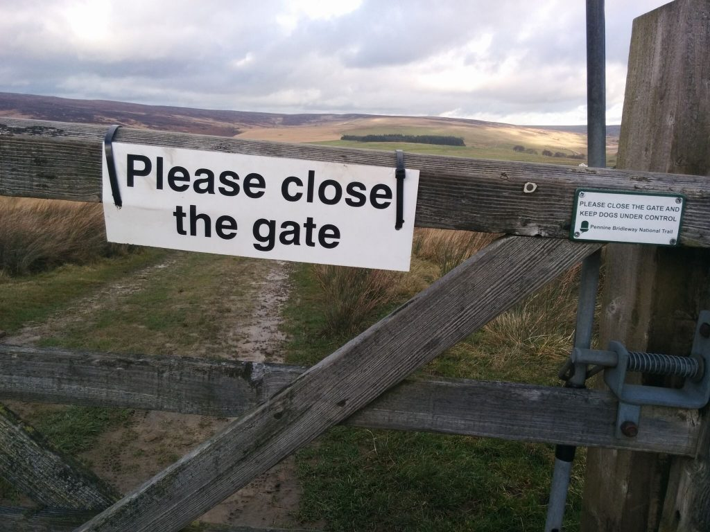 """Please close the gate"" sign."