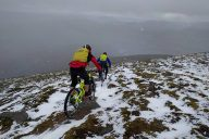 bikers on snowy mountain