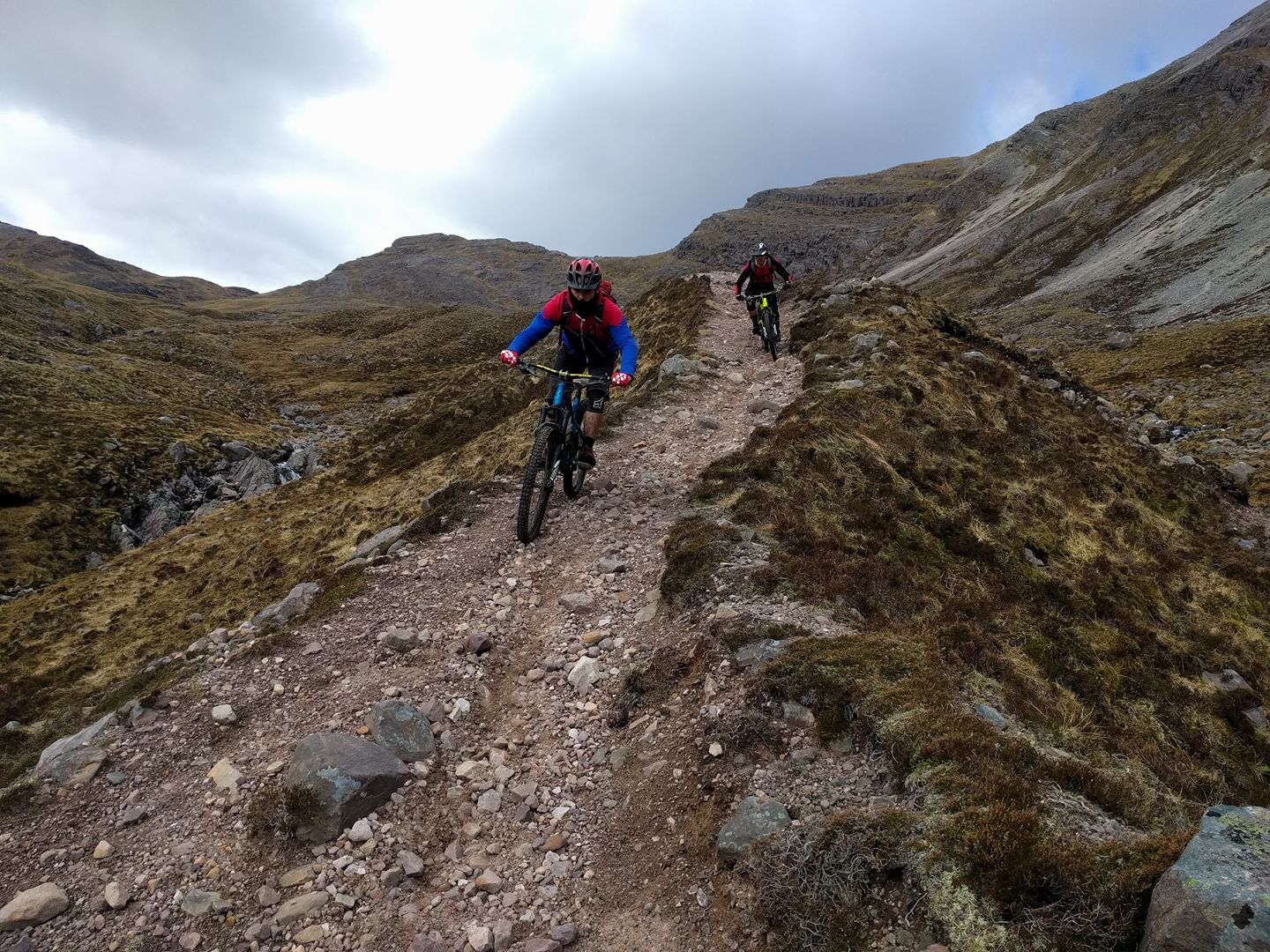 Two riders on the Achnashellach descent
